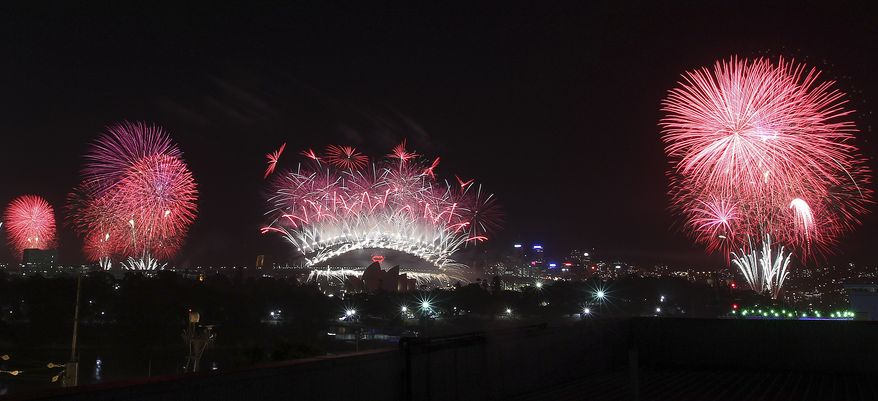 Fireworks explode above Sydney Harbor during New Year's celebrations in Sydney on Tuesday, Jan. 1, 2013. (AP Photo/Rob Griffith)