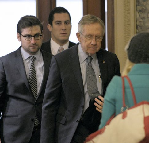 Senate Majority Leader Harry Reid (third from left), Nevada Democrat, arrives on Capitol Hill in Washington on Monday, Dec. 31, 2012, as fiscal cliff negotiations continued. (AP Photo/Susan Walsh)
