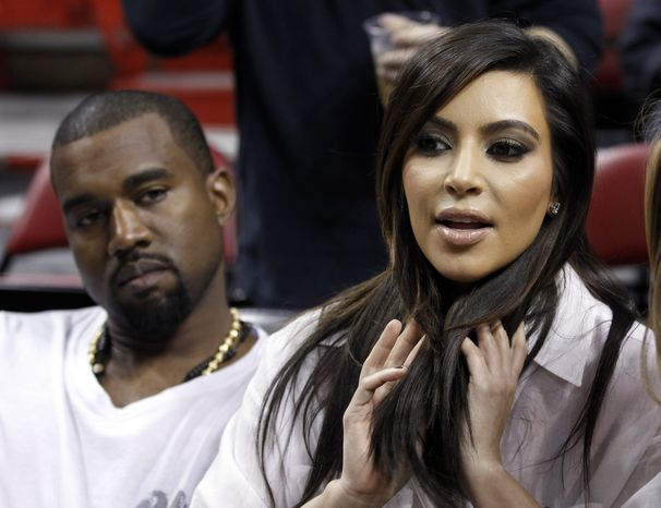 Kim Kardashian (right) and Kanye West attend an NBA basketball game between the Miami Heat and the New York Knicks on Thursday, Dec. 6, 2012, in Miami. (AP Photo/Alan Diaz)
