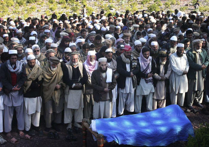 Pakistani tribesmen pray during the funeral of a paramilitary soldier who was kidnapped and executed by Taliban militants in Darra Adam Khel, Pakistan, on Sunday, Dec. 30, 2012. (AP Photo/Mohammad Zubair)