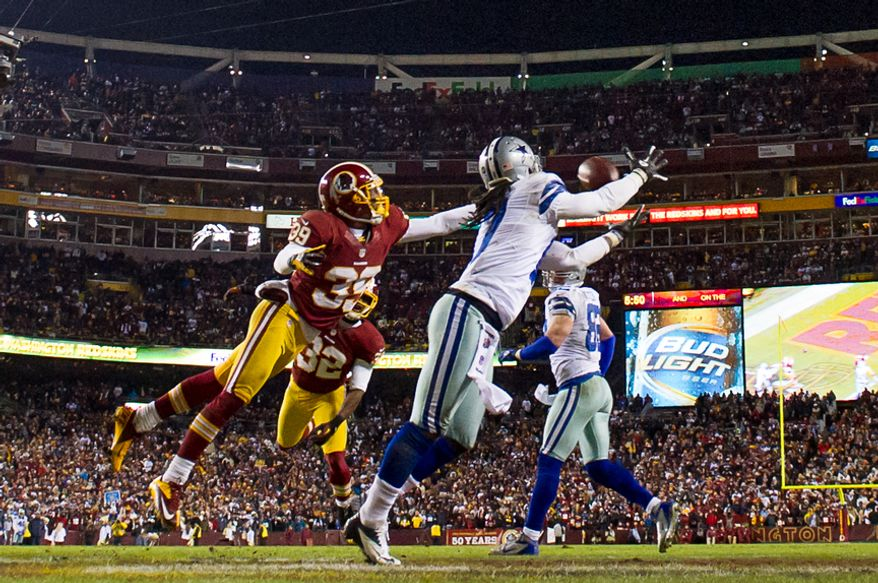 Dallas Cowboys wide receiver Dwayne Harris (17) converts a two-point conversion past Washington Redskins cornerback Richard Crawford (39) in the fourth quarter at FedEx Field, Landover, Md., Sunday, Dec. 30, 2012. (Andrew Harnik/The Washington Times)
