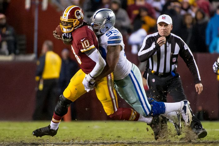 Dallas Cowboys outside linebacker Anthony Spencer (93) sacks Washington Redskins quarterback Robert Griffin III (10) for a 13-yard loss in the fourth quarter at FedEx Field, Landover, Md., Sunday, Dec. 30, 2012. (Andrew Harnik/The Washington Times)