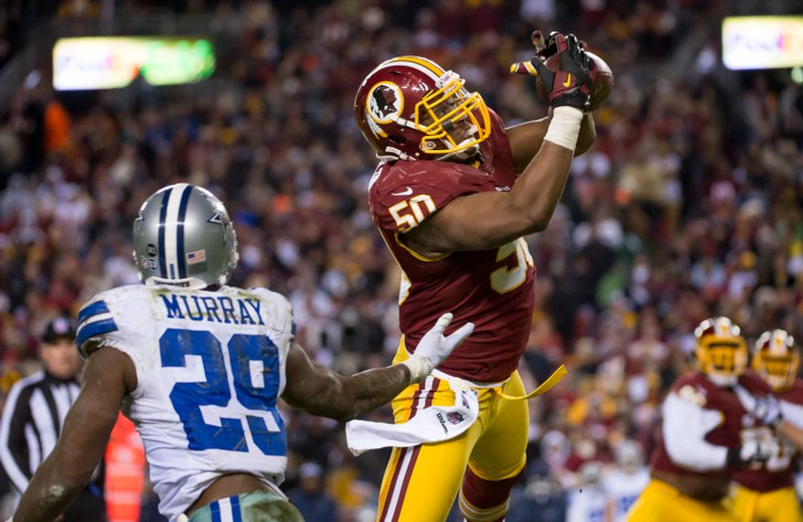 Washington Redskins outside linebacker Rob Jackson (50) intercepts a pass intended for Dallas Cowboys running back DeMarco Murray (29) in the fourth quarter as the Washington Redskins play the Dallas Cowboys at FedEx Field, Landover, Md., Sunday, Dec. 30, 2012. (Andrew Harnik/The Washington Times)