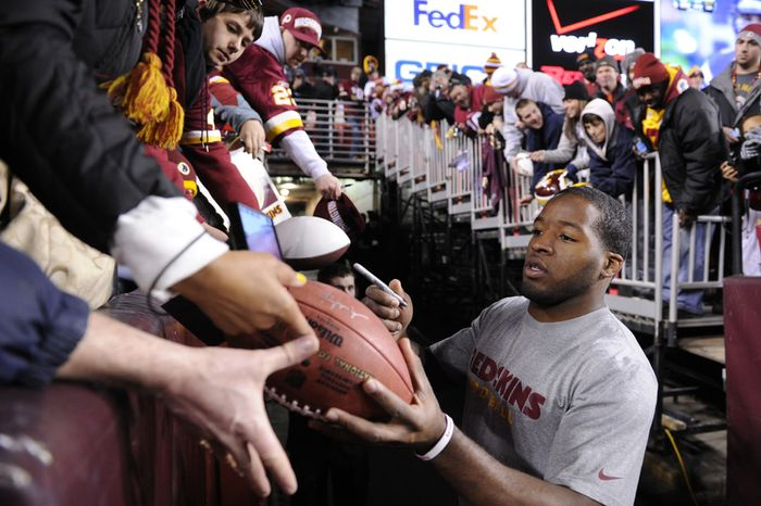 Washington Redskins running back Alfred Morris signs autographs for the fans before the game versus the Dallas Cowboys at FedEx Field, Landover, Md., Dec. 30, 2012. (Preston Keres/Special to The Washington Times)