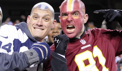 Bryson Jones (left) and Eric Alabiso (right), from Marine Corps Base Quantico, sport their teams' colors  at FedEx Field, Landover, Md., Dec. 30, 2012. (Preston Keres/Special to The Washington Times)