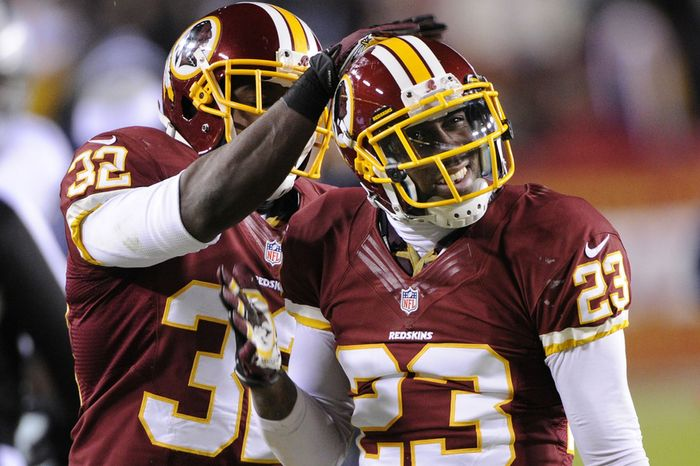 Washington Redskins cornerback DeAngelo Hall (23) is congratulated by defensive back Jordan Pugh (32) after stopping Dallas Cowboys wide receiver Dez Bryant in the third quarter at FedEx Field, Landover, Md., Dec. 30, 2012. (Preston Keres/Special to The Washington Times)
