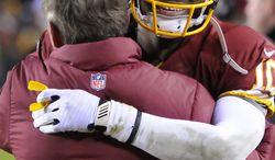 Washington Redskins quarterback Robert Griffin III (10) hugs head coach Mike Shanahan in the closing seconds as the Redskins secure the NFC East title at FedEx Field, Landover, Md., Dec. 30, 2012. (Preston Keres/Special to The Washington Times)