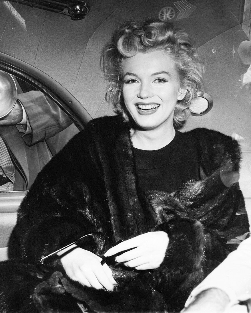 ** FILE ** Hollywood actress Marilyn Monroe smiles after arriving tousled from an overnight plane flight from Los Angeles to New York in this undated photo. (AP Photo)