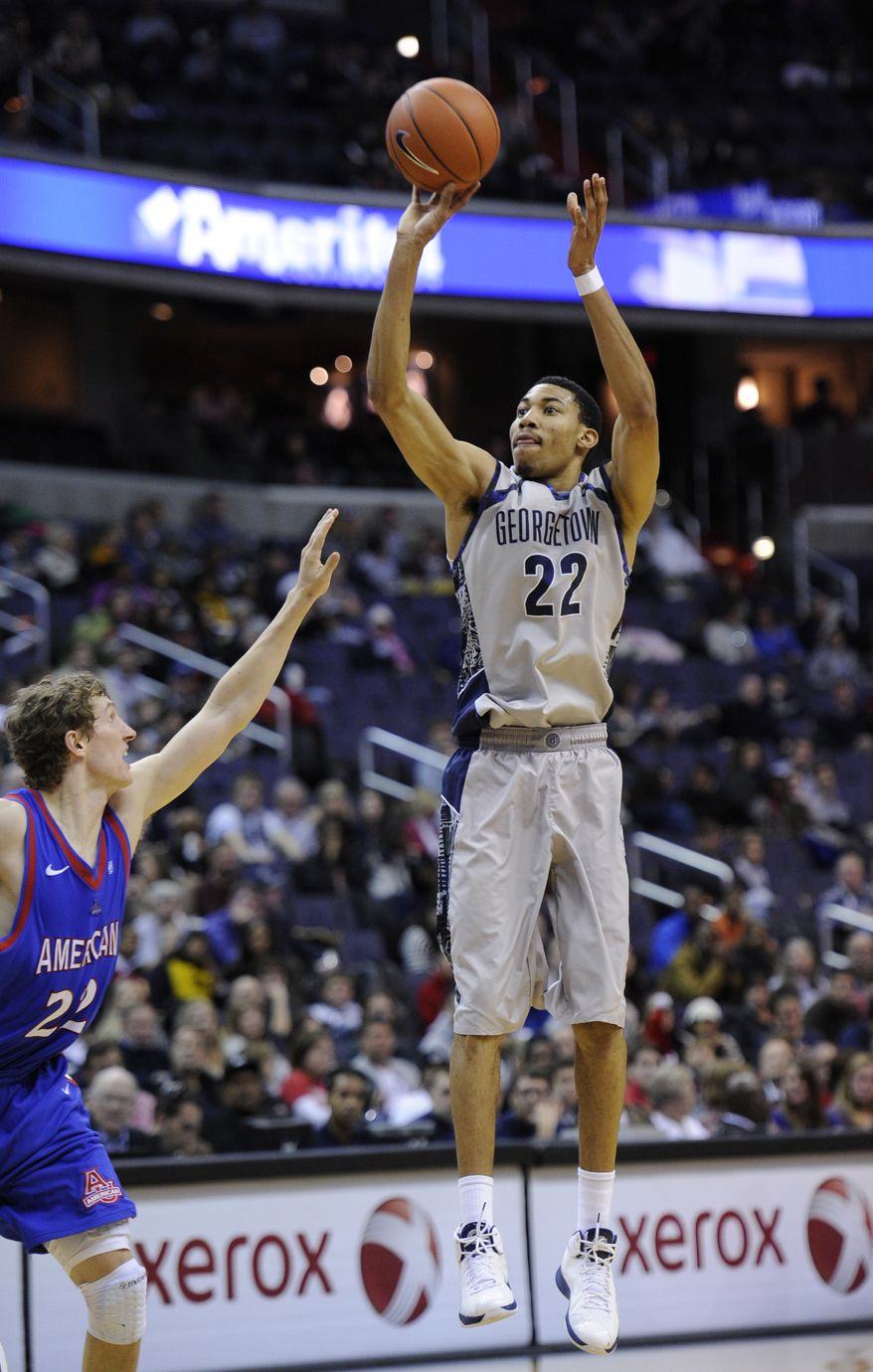 Georgetown forward Otto Porter, right, takes a shot against American guard John Schoof, left, during the second half of an NCAA college basketball game, Saturday, Dec. 22, 2012, in Washington. Georgetown won 65-48. (AP Photo/Nick Wass)