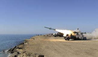 ** FILE ** A Ghader missile is launched from the area near the Iranian port of Jask, on the shore of the Gulf of Oman, during an Iranian navy drill on Tuesday, Jan. 1, 2013. (AP Photo/Jamejam Online, Azin Haghighi)