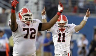 Georgia quarterback Aaron Murray (11) celebrates an 87-yard touchdown pass play with teammate Georgia offensive tackle Kenarious Gates (72) during the second half of the Capital One Bowl NCAA football game against Nebraska, Tuesday, Jan. 1, 2013, in Orlando, Fla. Georgia won the game 45-31.(AP Photo/John Raoux)