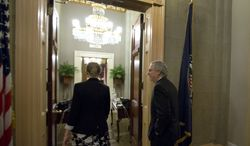 """Senate Minority Leader Mitch McConnell (right), Kentucky Republican, returns to his office after a vote on the """"fiscal cliff"""" deal on Capitol Hill on Tuesday, Jan. 1, 2013, in Washington. (AP Photo/Alex Brandon)"""