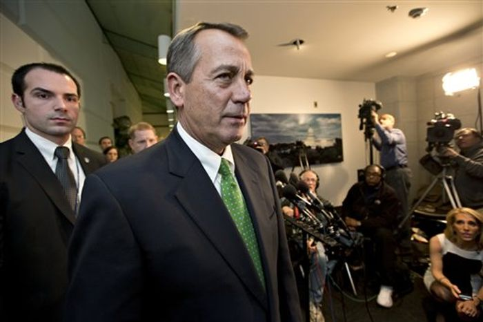 """Late on New Year's Day, Speaker of the House John A. Boehner, Ohio Republican, walks past reporters after a closed-door meeting meeting of House Republicans as the """"fiscal cliff"""" bill passed by the Senate last night waits for a vote in the GOP-controlled House, at the Ca"""