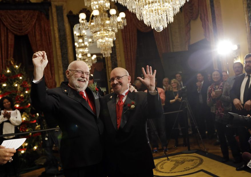 James Scales (left) and William Tasker celebrate their wedding at City Hall in Baltimore on Tuesday, Jan. 1, 2013. Same-sex couples in Maryland now are permitted to marry under a new law that went into effect after midnight on Tuesday. Maryland is the first state south of the Mason-Dixon Line to approve same-sex marriage. (AP Photo/Patrick Semansky)