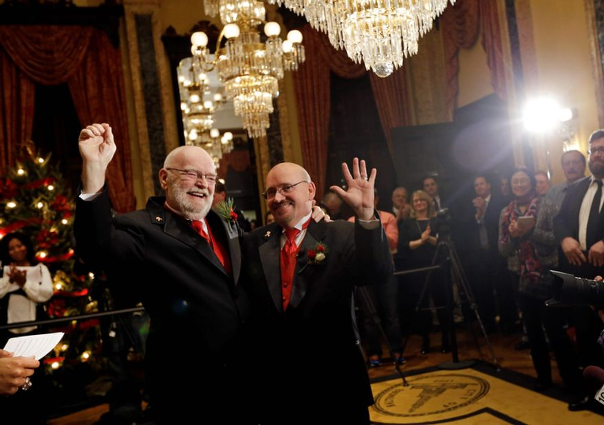 James Scales (left) and William Tasker react after their wedding ceremony at City Hall in Baltimore on Jan. 1, 2013. Same-sex couples in Maryland are now legally permitted to marry under a new law that went into effect after midnight on Jan. 1. Maryland is the first state south of the Mason-Dixon Line to approve same-sex marriage. (Associated Press)