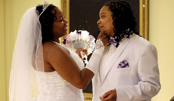 Darcia Anthony (left) and her partner, Danielle Williams, chat before their marriage ceremony at City Hall in Baltimore on Tuesday, Jan. 1, 2013. Same-sex couples in Maryland are now legally permitted to marry under a new law that went into effect after midnight on Tuesday. Maryland is the first state south of the Mason-Dixon Line to approve same-sex marriage. (AP Photo/Patrick Semansky)