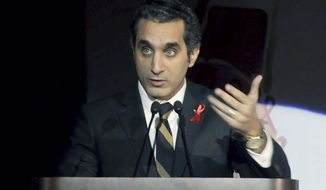 Egyptian TV host Bassem Youssef addresses attendees at a gala dinner party in Cairo on Saturday, Dec. 8, 2012. Egyptian prosecutors on Tuesday launched an investigation against Mr. Youssef, a popular television satirist, for allegedly insulting the president in the latest case raised by Islamist lawyers against outspoken media personalities. (AP Photo/Ahmed Omar)