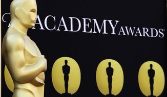 An Oscar statue stands on the red carpet outside the Kodak Theatre as preparations continued for the 82nd Academy Awards in Los Angeles in 2010. (AP Photo/Amy Sancetta)