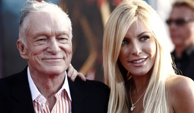 "Hugh Hefner, founder of Playboy magazine, and Crystal Harris, one of the publication's Playmates of the Month in 2009, arrive at the premiere of ""Iron Man 2"" at the El Capitan Theatre in Los Angeles in 2010. (AP Photo/Matt Sayles)"