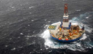The mobile drilling unit Kulluk is towed by the tugs Aiviq and Nanuq in 29 mph winds and 20-foot seas 116 miles southwest of Kodiak, Alaska, on Sunday, Dec. 30, 2012. (AP Photo/U.S Coast Guard, Chris Usher)