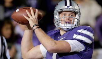Kansas State quarterback Collin Klein, a fifth-year senior and Heisman Trophy finalist, became the first quarterback in the BCS era to pass for 20 touchdowns and run for 10 in successive seasons. (Associated Press)