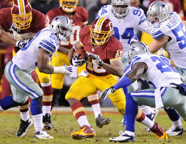 Part of the Redskins' stunning season has been rookie running back Alfred Morris breaking the single-season rushing record with 1,613 yards. Morris was an unheraded sixth-round pick out of Florida International. (Preston Keres/Special to The Washington Times)