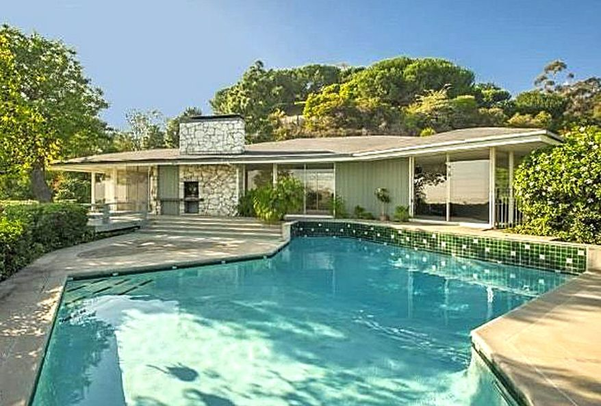 Want to own a bit of history? A California house once owned by Ronald and Nancy Reagan is on the market with an asking price of $4,999,000. An octagonal swimming pool is among the features of the four-bedroom ranch-style home. (Coldwell Banker)