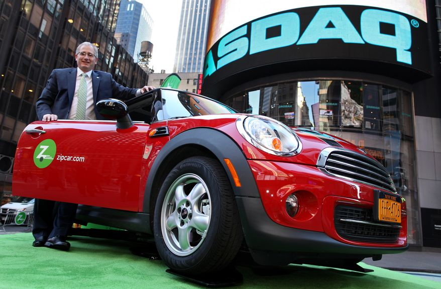 **FILE** Zipcar Chairman and CEO Scott Griffith stands April 14, 2011, with a Zipcar Mini-Cooper before the opening bell at the NASDAQ Market Site in New York. (Associated Press/Zipcar.com, Craig Ruttle)