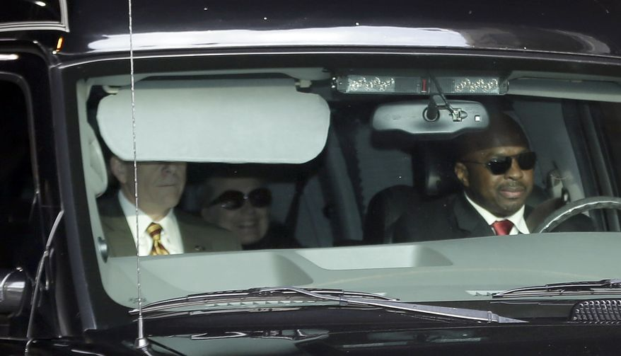 Secretary of State Hillary Clinton (center) is transported on the New York Presbyterian Hospital complex in New York on Jan. 2, 2013. Officials say Clinton, who was admitted to the New York hospital three days prior, continues to be treated with blood thinners to dissolve a clot in the vein behind the right ear. Doctors found the clot during a follow-up exam stemming from a concussion she suffered in early December. (Associated Press)