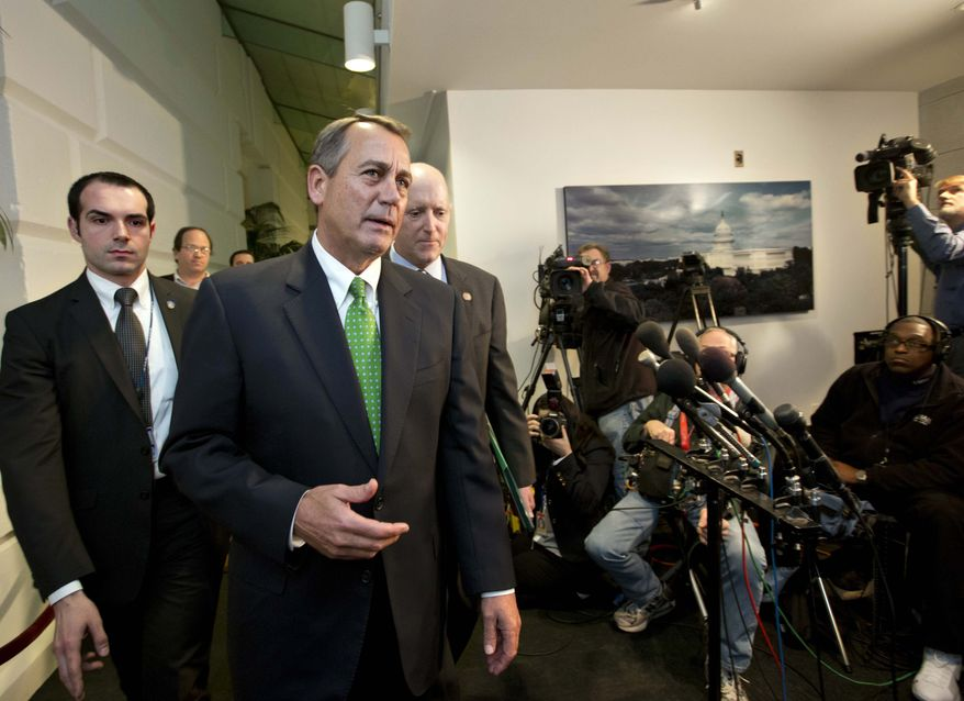 "Speaker of the House John Boehner, R-Ohio, walks with House Ways and Means Committee Chairman Dave Camp, R-Mich., following a closed-door GOP meeting on the ""fiscal cliff"" bill. It passed the Senate on Monday night and the House on Tuesday, Jan. 1, 2013. (AP Photo/J. Scott Applewhite)"