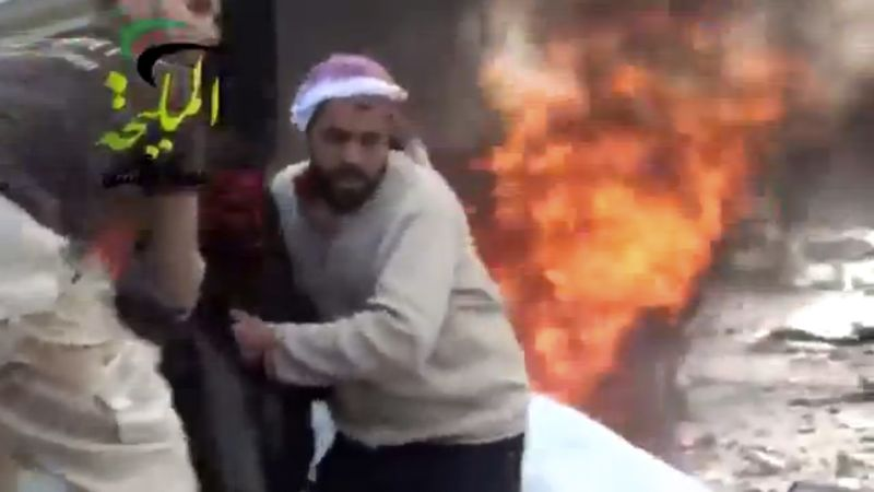 A wounded man is pulled from the site of a Syrian government airstrike on a gas station in the eastern Damascus suburb of Mleiha, Syria, on Wednesday, Jan. 2, 2013. This citizen-journalist image was taken from video that was authenticated based on its contents and other AP reporting. (AP Photo/Shaam News Network via AP video)