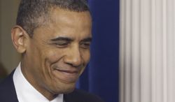 ** FILE ** President Obama smiles in the Brady Press Briefing Room at the White House. (Associated Press)