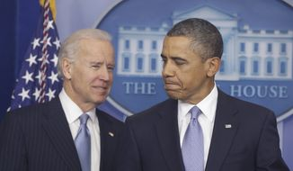 President Obama and Vice President Biden arrive Jan. 1, 2013, to make a statement regarding the passage of the fiscal cliff bill in the Brady Press Briefing Room at the White House in Washington. (Associated Press)