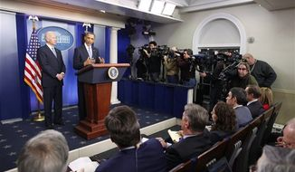 President Obama and Vice President Biden make a statement regarding the passage of the fiscal cliff bill in the Brady Press Briefing Room at the White House in Washington on Jan. 2, 2013. (Associated Press)