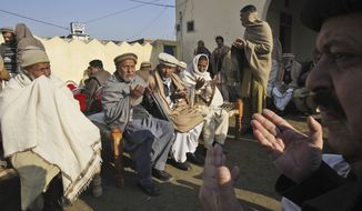 Pakistani men, chant prayers, during the funeral procession of aid worker Lubna Mahmoud, 26, who was killed on Tuesday, by gunmen, in Swabi, Pakistan, Wednesday, Jan. 2, 2013. (AP Photo/Mohammad Sajjad)