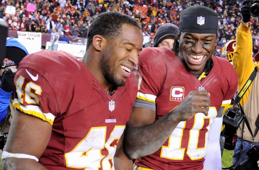 Good times have been plentiful for Alfred Morris (left) and Robert Griffin III, who have made the biggest impact as rookie backfield mates since Otto Graham (below) and Marion Motley for Cleveland in 1946. (Preston Keres/Special to The Washington Times)