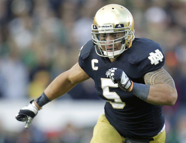 FILE - In this Oct. 20, 2012, file photo, Notre Dame linebacker Manti Te'o chases the action during the second half of an NCAA college football game against the BYU in South Bend, Ind. Alabama's Barrett Jones and Notre Dame's Te'o are All-Americans and national award winners. They're also fine students who emphasize faith and postponed big money from the NFL to stay in school.(AP Photo/Michael Conroy, File)