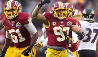 Washington Redskins linebacker Lorenzo Alexander (97) celebrates after forcing a three and out against the Baltimore Ravens in the second half at FedEx Field in Landover Md., on Sunday, December 9, 2012. Washington Redskins won 31 to 28. (Craig Bisacre/The Washington Times)