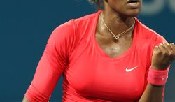 Serena Williams of the United States reacts after winning a point during her quarterfinal match against her compatriot Sloane Stephens at the Brisbane International tennis tournament held in Brisbane, Australia, Thursday, Jan. 3, 2013.  (AP Photo/Tertius Pickard)