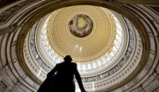 A statue of President George Washington is seen in the foreground at the Rotunda of the U.S. Capitol. (AP Photo/J. Scott Applewhite) ** FILE **