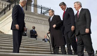 Vice President Joseph R. Biden watches at left as Sen. Mark Kirk, R-Ill., second from left, accompanied by Sen. Joe Manchin, D-W.Va., second form right, and Senate Majority whip Richard Durbin of Ill., right, walks the steps to the Senate door of the Capitol building on Capitol Hill in Washington, Thursday, Jan. 3, 2013. (AP Photo/ Evan Vucci)