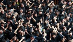 Shiite Muslim worshippers beat themselves inside the holy shrine of Imam Hussein to mark the Muslim festival of Arbaeen in Karbala, 50 miles south of Baghdad, on Thursday, Jan. 3 , 2013. The holiday marks the end of the 40-day mourning period after the anniversary of the seventh-century martyrdom of Imam Hussein, the Prophet Muhammad's grandson. (AP Photo/ Hadi Mizban)