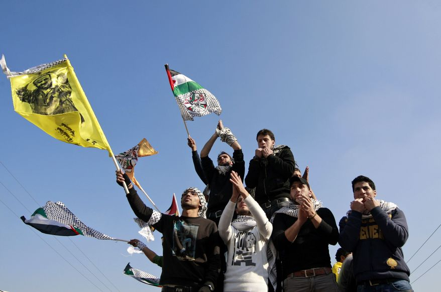 Palestinians participate in a rally celebrating the 48th anniversary of the Fatah movement in the West Bank city of Nablus on Thursday, Jan. 3, 2013. (AP Photo/Majdi Mohammed)