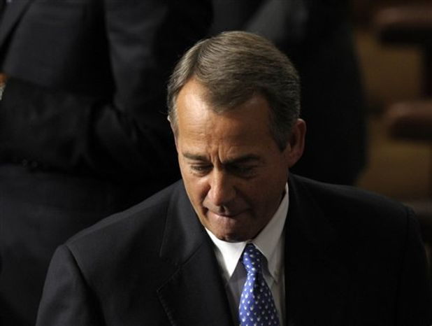House Speaker John A. Boehner of Ohio walks in House of Representatives chamber on Capitol Hill in Washington, Thursday, Jan. 3, 2013, as the 113th Congress began. (AP Photo/Susan Walsh)
