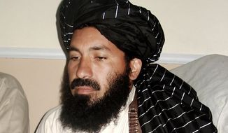 ** FILE ** In this April, 20, 2007 file photo, Pakistani militant commander Maulvi Nazir meets his associates in South Waziristan, Pakistan, near the Afghani border. Five Pakistani security officials said the commander, Nazir, was reportedly among nine people killed in a missile strike on a house in the village of Angoor Adda in the South Waziristan tribal region early Thursday. (AP Photo/Ishtiaq Mahsud)