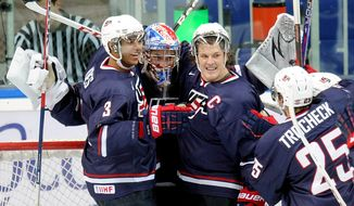 USA's team players celebrate during a semi-final match against Canada at  the World Junior Ice Hockey championship in Ufa, Russia, Thursday, Jan. 3, 2013. (AP Photo/Yuri Kuzmin, KHL)