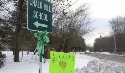 A sign for Chalk Hill School is seen in Monroe, Conn., Wednesday, Jan. 2, 2013. Sandy Hook Elementary School students will begin classes on Thursday at Chalk Hill School. The school was overhauled specially for them in the neighboring town of Monroe, Conn. (AP Photo/Jessica Hill)