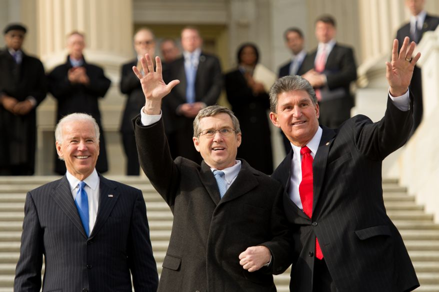 Vice President Joseph R. Biden (left) watches as Sen. Mark Kirk (center), Illinois Republican, accompanied by Sen. Joe Manchin III, West Virginia Democrat, waves to applauding crowds as he walks up the steps to the Senate door at the U.S. Capitol in Washington on Thursday, Jan. 3, 2013. Mr. Kirk returned to Congress after suffering a stroke last January. (Andrew Harnik/The Washington Times)