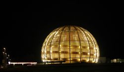 ** FILE ** In this March 30, 2010, file picture the globe of the European Organization for Nuclear Research, CERN, is illuminated outside Geneva, Switzerland. (AP Photo/Anja Niedringhaus,File)