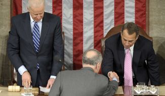 Vice President Joseph R. Biden watches at left as Sen. Charles Schumer, D-N.Y., center, shakes hands with House Speaker John Boehner of Ohio, right, in the House Chamber during the counting of Electoral College votes on Capitol Hill in Washington, Friday, Jan. 4, 2013. Biden presided over a Joint Session of Congress Friday as four members of the House and Senate took turns announcing the votes that had been tallied in state capitals last month affirming the re-election of Barack Obama as President of the United States. (AP Photo/Susan Walsh)